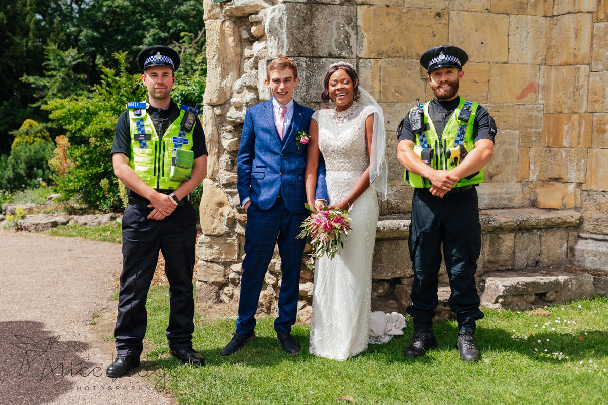 wedding couple in York museum gardens with police