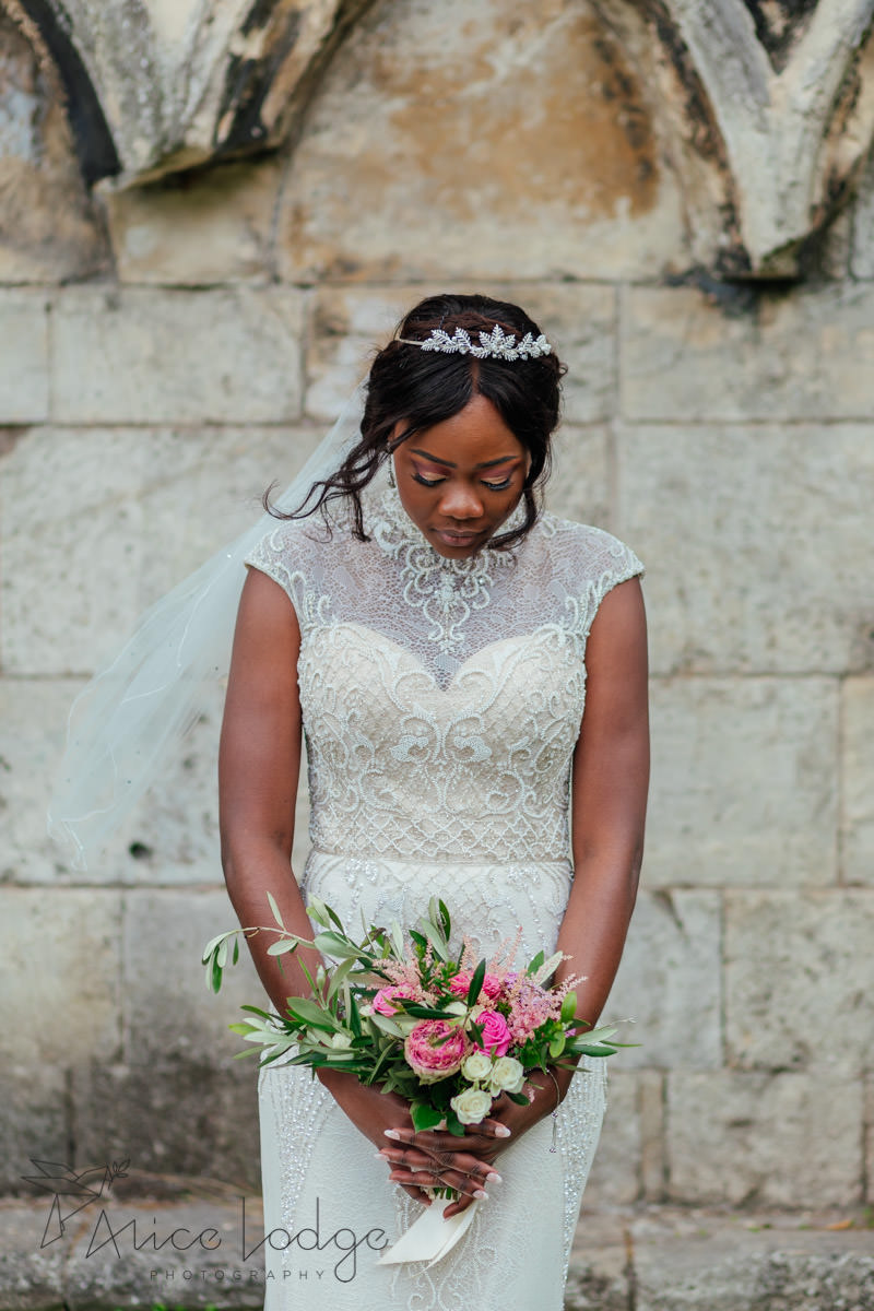 bride with pink flowers