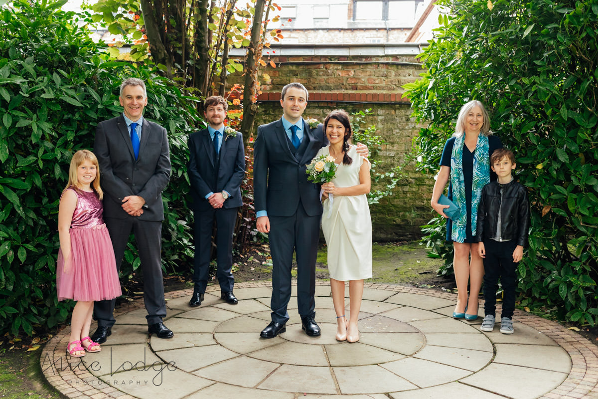 socially distant wedding group picture