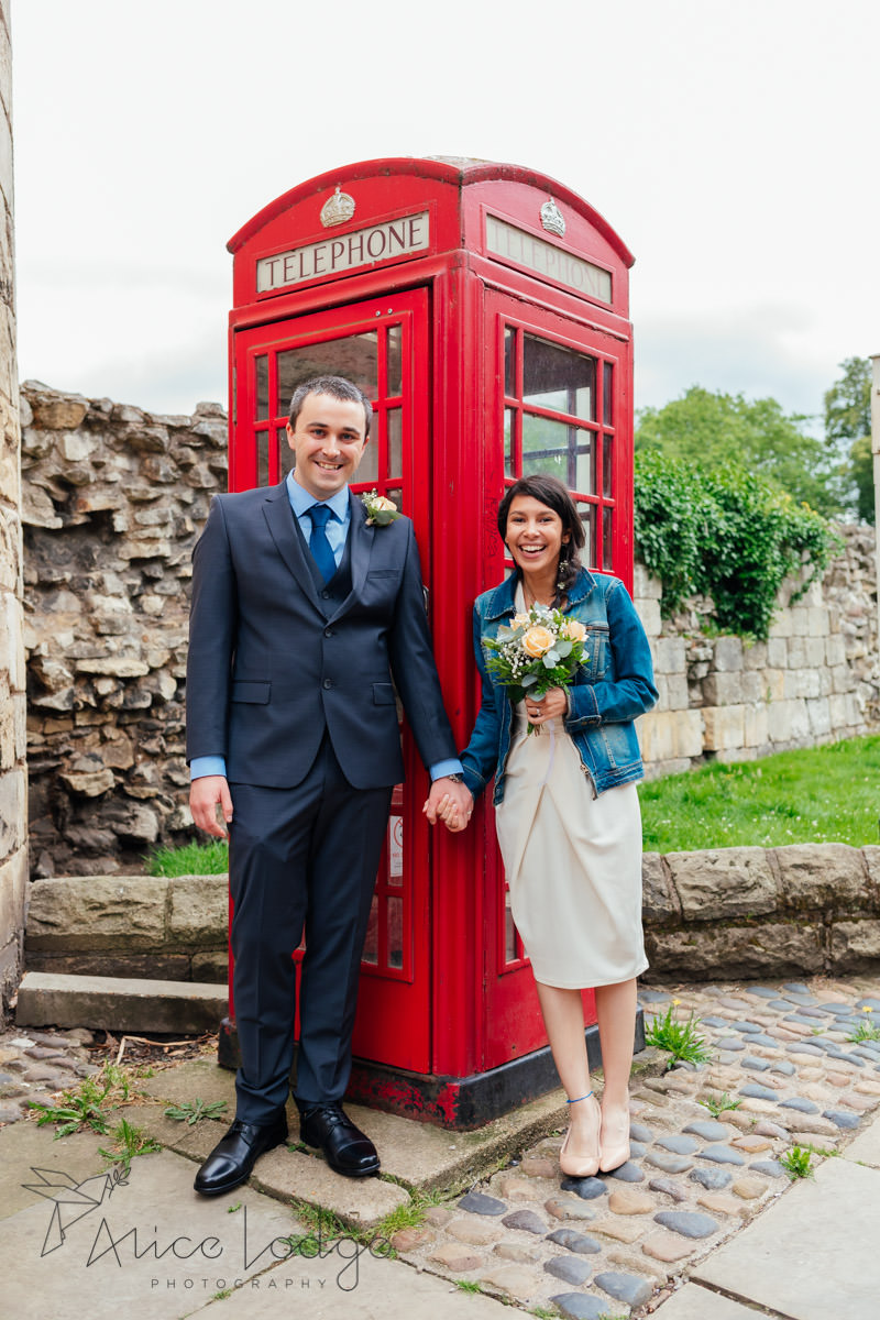 wedding couple in front of red phone box